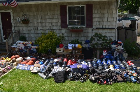Donated sports gear in front of house