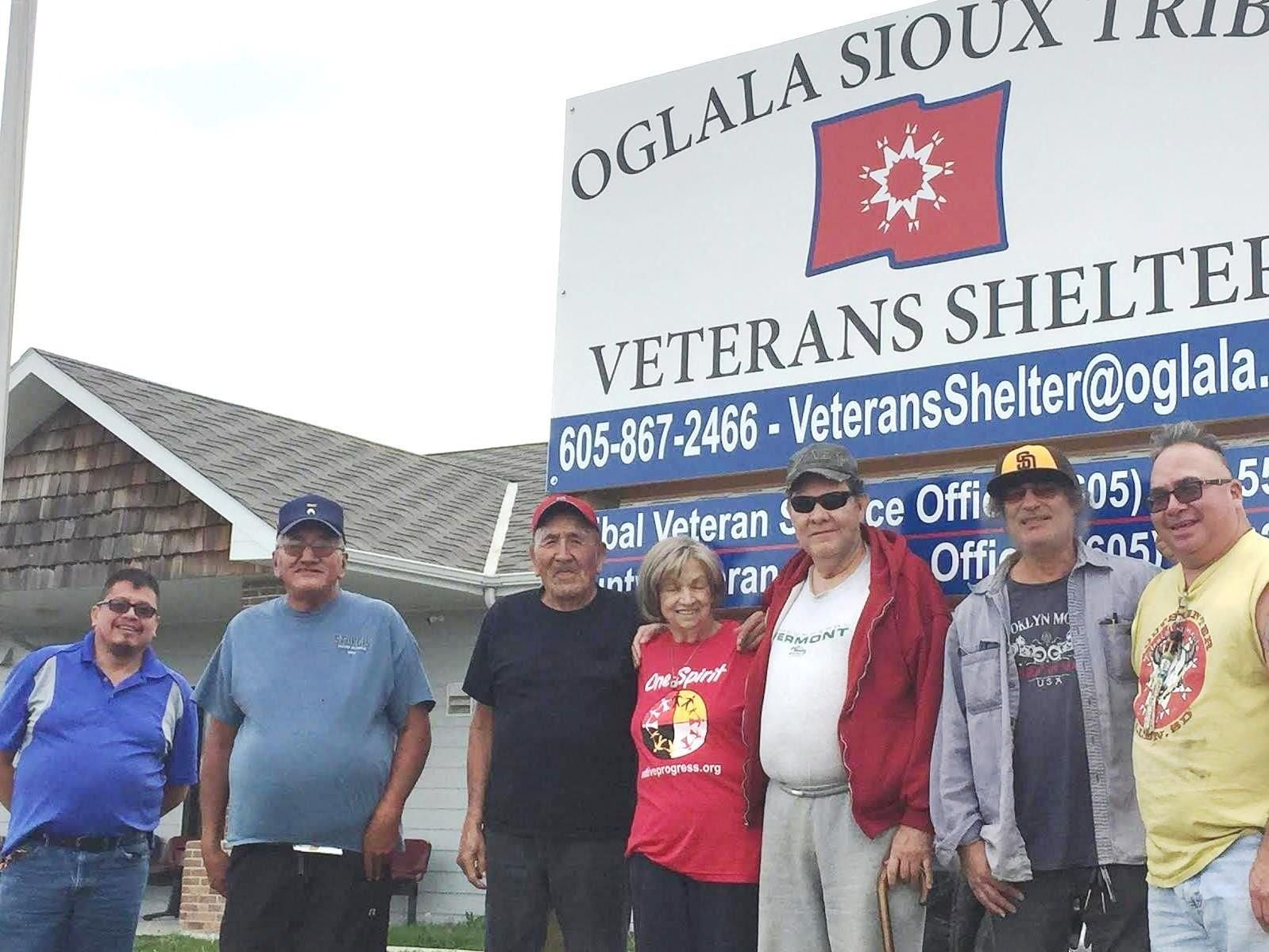 Team in front of Veteran's shelter